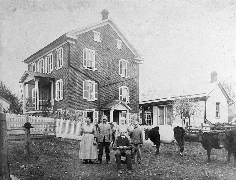 Smith family in front of 1885 farmhouse
