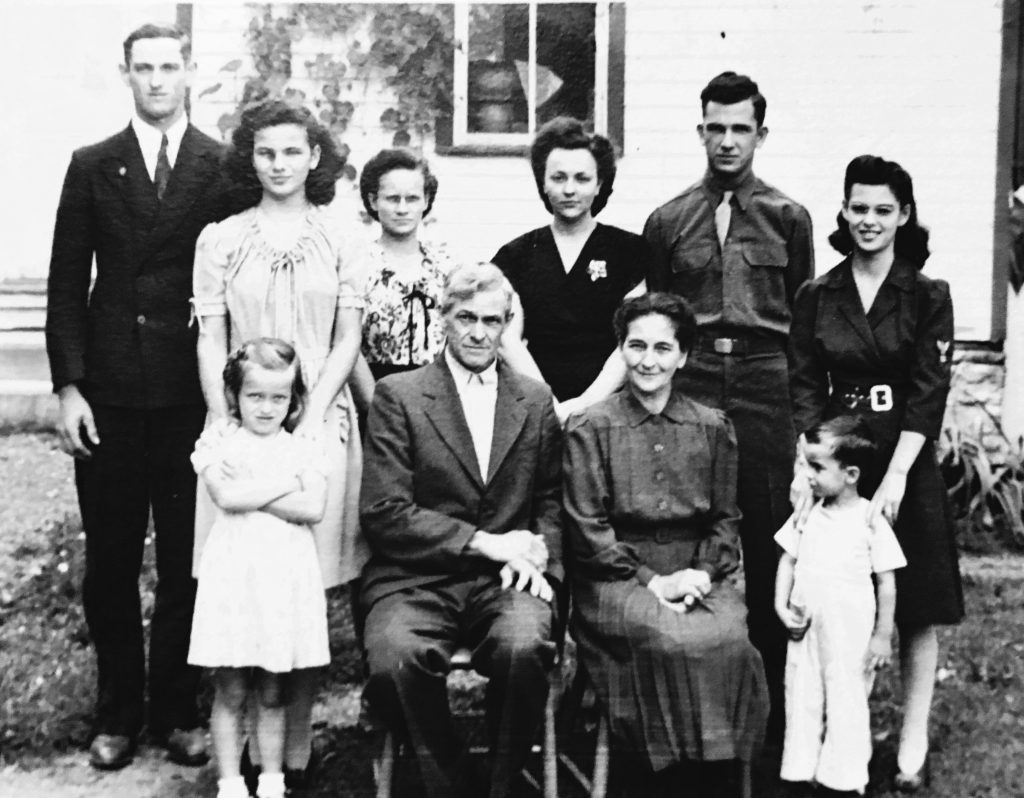 Banks and Myrtle Smith family in front of the washhouse.